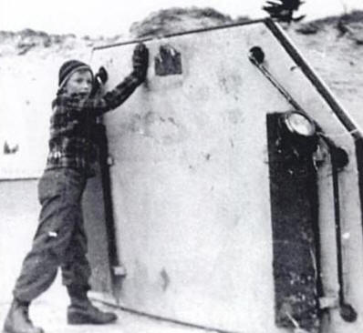 Young Chuck Jensen with the cabin roof of the Indian