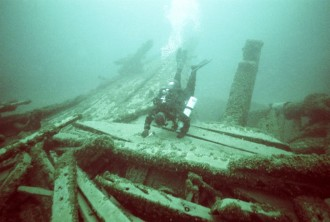 Diver Craig Rich explores the Ironsides' stern area